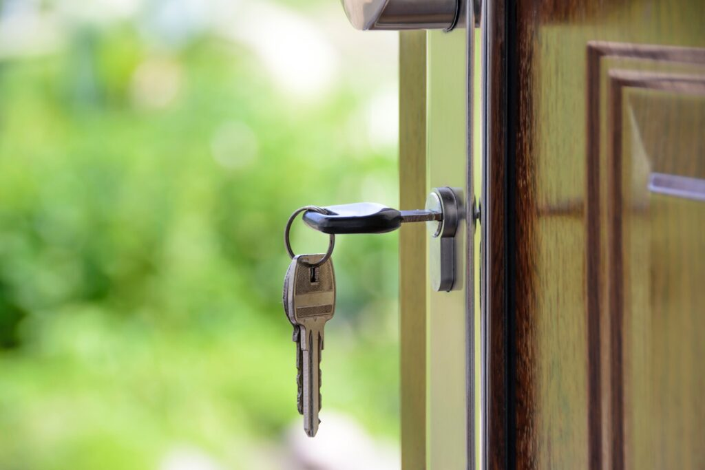 house key inserted in the front door - featured image