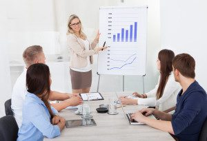 business meeting with chart presentation - featured image